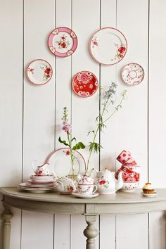 This could be a cute decoration for my red kitchen, especially if I can find old china at antique shops!