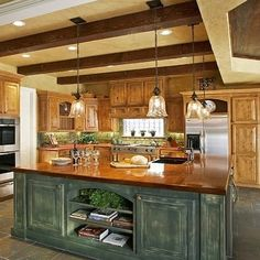 Decorative Country Kitchen Remodel Idea with Brown Wooden Kitchen Cabinet with Silver Fridge and Dark Green Kitchen Island with Brown Countertop plus Glass Penant Lights together with Gray Floor Tile - Green Kitchen Island, Dark Green Kitchen, Rustic Kitchen Island, Country Kitchen, Kitchen Islands, Texas Kitchen, Maple Kitchen, Vintage Kitchen, Rustic Kitchen Lighting