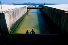 Two boys contemplating a swim, Ipanema (Rio de Janeiro, Brazil) (photo by Sharisse Coulter)