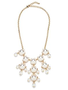 Ladies who lunch gets a decidedly downtown infusion with this statement piece.  Pearlescent beads are neatly arranged into a cascading chandelier pattern for a modern update on the classic feminine accouterment.  This is part of the BaubleBar + Atlantic-Pacific Collection