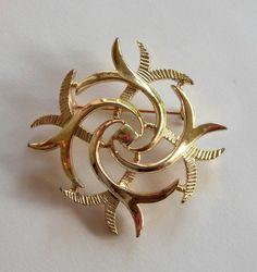 Vintage Gold Tone Sarah Coventry Celtic Design Brooch. $8.00, via Etsy.