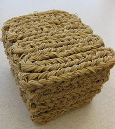 """""""samar (2009) by An Pham. Braided rubber bands formed into a cube."""