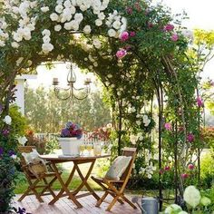 DIY Garden Sitting Areas To think about for back yardsmaller patio with stepables surrounding? Arbor and plants instead of umbrella? The post DIY Garden Sitting Areas appeared first on Garden Easy. Diy Garden, Garden Cottage, Dream Garden, Backyard Cottage, Garden Projects, Spring Garden, Garden Shade, Rose Cottage, Garden Beds