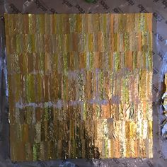 Making art. Finished collage from new and recycled confectionery and chocolate wrappers. Made from golden wrapper plamil dairy  free, temple organic, trebor lemon softmints, after eight #qualitystreetUK #rolo #nestleUK #FerreroUK #audreyschocs #plamilfoods #trebor  #tesco #foil #foils #art #artwork #artist #collage #contemporary #contemporaryart #contemporarycollage #modern #modernart #moderncollage #abstract #abstractart #abstractcollage #loutheartist1