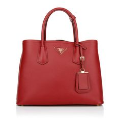 You are looking for a very classy and luxury handbag in red: find the Prada Shopping Saffiano Cuir Fuoco! This charming handbag might be one of your best styling-essentials in your wardrobe. Fashionette.de