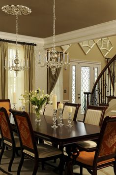 Two Chandlers Over Dinning Room Table And Large And Fitting Floral  Centerpiece.