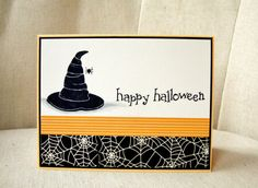 The hat, spider and sentiment are stamped with black ink on cream colored cardstock. I added a little glittery spider web for the spider to hang from. The card base is marigold cardstock. The inside, which is blank, has a cream colored panel adhered to it for easier writing. This card measures 4 1/4 x 5 1/2 and comes with a white envelope. Please feel free to email me if you have any questions. Thanks for looking