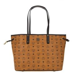 MCM Project Visetos Reversible Shopper Medium Cognac in cognac,... ($725) ❤ liked on Polyvore featuring bags, handbags, brown, drawstring purse, white handbags, brown handbags, cognac purse and mcm purse