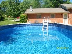 15 x 30 oval above ground pool Maryville, Tn by Poolman / Concrete Doctor
