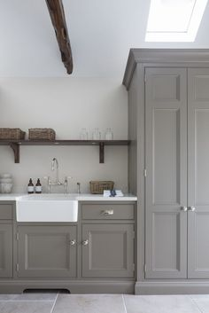 This utility room at a project in Sevenoaks Kent has a large Villeroy & Boch sink and Perrin & Rowe Ionian tap and rinse #humphreymunson