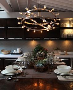 We love the use of chandeliers in the kitchen to add some flair.