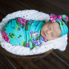 Adorable newborn swaddle wrap with hat and headband. You'll definitely want to add this to your hospital bag to welcom your baby girl!
