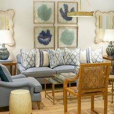 Living room done in blues and greens giving off a beach vibe.