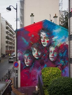 C215 creates a vibrant new mural on the streets of Paris, France