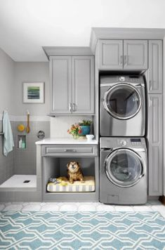 Gray laundry room with pet bed and dog washing station A simple rearrangement of task areas takes advantage of vertical space to make cleanup easier for both two- and four-legged family members Grey Laundry Rooms, Laundry Room Layouts, Farmhouse Laundry Room, Laundry Room Organization, Laundry Room Design, Basement Laundry, Laundry Decor, Laundry Storage, Laundry Closet