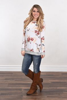 An adorable top with floral and a solid grey back! True to size. Model is 5'5'' a size 1 wearing a small. Material: 85% polyester, 10% Rayon, 5% Spandex Product Sizing Chart Size Bust Hip Length Waist
