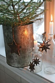 Rustic country Christmas holiday vignette with glass bottles, white candles, stars, and evergreens. Natural Christmas, Primitive Christmas, Scandinavian Christmas, Country Christmas, Beautiful Christmas, Simple Christmas, Winter Christmas, Christmas Stars, Merry Christmas