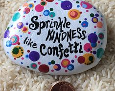 Sprinkle kindness like confetti - colorful painted rock
