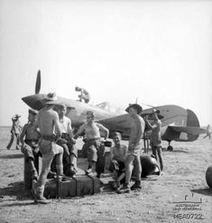 Royal Australian Air Force and Italian ground crew personnel together at the Grottaglie airfield, Southern Italy, summer 1943. In the backgr...