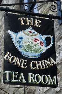 Thé, enseigne
