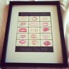 Kisses for the bride. Great idea for a bachelorette party! Give all the guests a lipstick and have them kiss a square piece of paper. Arrange in a frame to give to the bride.