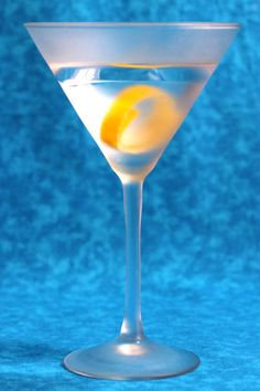 The classic dry Gin Martini contains just three simple ingredients - gin, vermouth, and either a lemon twist or olives. Learn how to make one at home. Dry Gin Martini, Martini Mix, Cocktail Party Food, Party Food And Drinks, Cocktail Videos, Happy Hour Drinks, Drink Specials, Classic Cocktails, Craft Cocktails