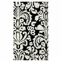Anchor neutral furniture with this artful design, showcasing a hand-tufted pile and fleur-de-lis motif.