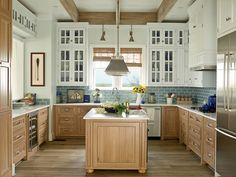 New Home Interior Design: The Ultimate Beach House - love the lower brown cabinets with the blue tile and white upper cabinets Beautiful Kitchens, Home, Beach Kitchens, Beach House Kitchens, Kitchen Decor, House Rooms, Beach House Room, Home Kitchens, Kitchen Design