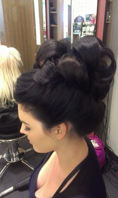 A funky updo by one of our senior stylists Marlene on our beautiful junior stylist Stephanie
