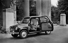 Photo-journalistMarilyn Silverstone sitting in her car in Ischia. 1950/1960