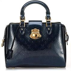 A classic Louis Vuitton satchel in bleu nuit Monogram Vernis with golden brass hardware. Details include two flat handles, a belted pushlock detail, zip closure, front and back pockets, and fully lined interior with two open pockets. New Handbags, Gucci Handbags, Handbags Online, Satchel Handbags, Luxury Handbags, Luxury Purses, Louis Vuitton Satchel, Louis Vuitton Handbags, Louis Vuitton Monogram