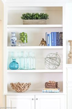 Wow, these bookshelves are GORGEOUS! This post walks through how to decorate bookshelves from start to finish and has plenty of bookshelf decorating ideas if Arranging Bookshelves, Styling Bookshelves, Decorating Bookshelves, How To Decorate Bookshelves, Green Bookshelves, Bookshelves In Living Room, Bookshelves Built In, Bookcases, Coastal Decor