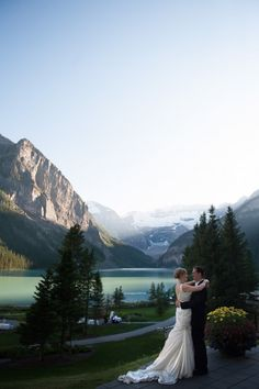 This wedding photo taken in the Rocky Mountains is absolutely breathtaking.