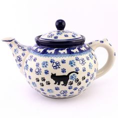 Polish pottery - how cute is this teapot with a cat on it? It can be found among newest pieces at http://slavicapottery.com