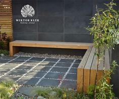 Modernist bench in the fresh established garden.