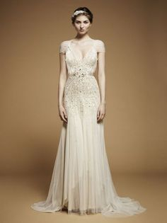 the wedding dress with gold bits... in love with this one too