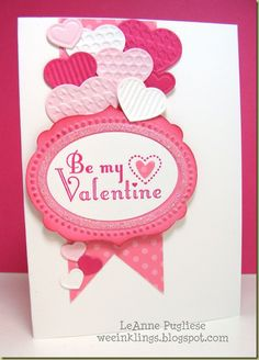 lovely handmade Valentine ... luv all the heart die cuts with different embossing folder texture ... glitter ring around the oval message ...