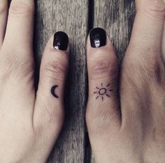 Tiny Sun and Moon Finger Tattoo.