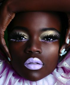 Lime Crime lipstick in D'Lilac, modeled by Atim Birungi.