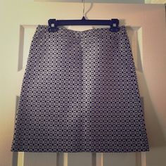 Banana Republic navy&white geometric A-Line skirt Banana Republic navy and white geometric skirt with pockets  A-Line skirt that above the knee and is lined. There is a stain across the very top of the skirt, which I tried to capture in the last pic. It's not noticeable while on. Banana Republic Skirts