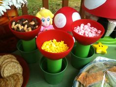 wii theme - princess peach party - cute idea for snacks/decor - use bowls and flower pots to look like the flowers in the game or mushrooms
