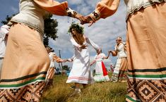 Belarusian women take part in the Rusalle festival (the holiday of mermaids) in the village of Sosny, Belarus