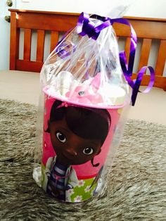 Party favour cups with Doc McStuffins party favour toys and girls lipgloss