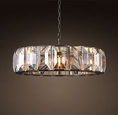 """CRYSTAL CHANDELIER 43""""  Inspired by a German chandelier from the 1970s, our fixture evokes the boldness and glamour of the era. A band of faceted crystal glass prisms reflects and refracts the light, capturing the essence of emerald-cut diamonds.  Overall: 43¼"""" diam., 17""""H Weight: 154 lbs.   IN NOW"""