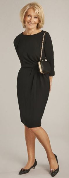 Black ruched dress with sleeves, £45, scored a perfect 10/10 for dressing up or down