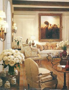 A little on the fancy side for me, but like the idea of the paneled walls, beamed ceiling, and neutral finishes. designer jeannie Huff.