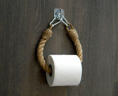 The toilet paper holder consists of natural jute rope and a ., The toilet paper holder consists of natural jute rope and a decoration. The toilet paper holder consists of natural jute rope and a . Industrial Toilets, Industrial Bathroom Design, Rope Decor, Wall Decor, Nautical Bathroom Decor, Parisian Bathroom, Beach Theme Bathroom, Nautical Decor Ideas, Bath Room Decor