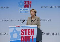 German Chancellor Angela Merkel makes an address during an anti-Semitism demo at Berlin's Brandenburg Gate September 14, 2014. Background reads ' Stand up !'. (REUTERS/Fabrizio Bensch)
