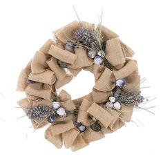 """Find the feel of the East Coast Shoreline with this 18"""" Seashell & Dried Floral Wreath. Blue mussel shells, English lavender, scallops and beach grass come together on a natural twig base. Each is designed with woven burlap to give this wreath a relaxing beach feel. With a more relaxed beach design, this wreath can match several decors any time of year. http://www.deliverstar.com/Beachy-Burlap-18-Seashell-Dried-Floral-Wreath-P2703C54.aspx"""
