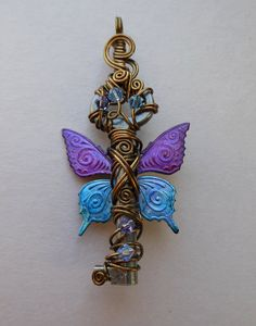 Butterfly Winged Key Pendant -- Purple and Blue Inked Patterned Butterfly Winged Wire Wrapped Antique Key with Swarovski Crystals